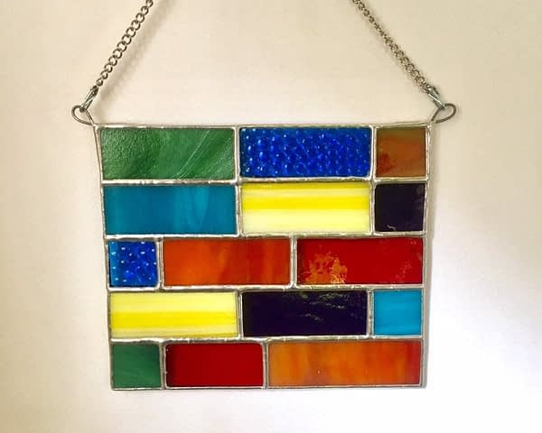 rainbow colored stained glass mountain woman products