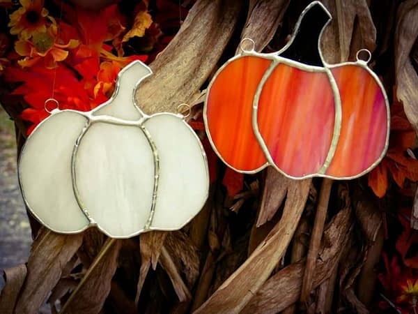 White & Orange stained glass pumpkins in front of corn stalks