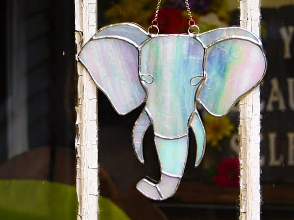 Iridescent White Elephant in Stained Glass Mountain Woman Products