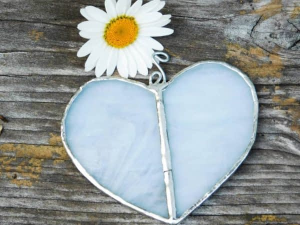 white heart stained glass suncatcher on rustic wood background