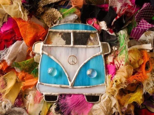 Aqua Blue VW Bus Suncatcher on a rag rug