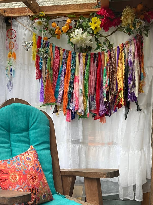 indian sari garland hanging in front of window mountain woman products