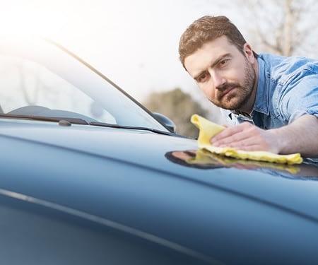 guy waxing car