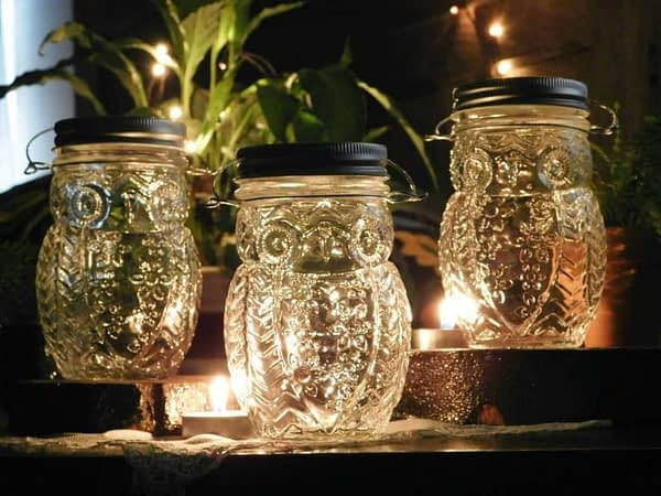 Clear hanging owl jar candle holder vases.